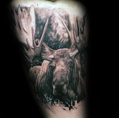 Man With Tattoo Of Moose On Thigh Of Leg