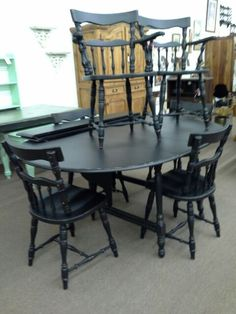 $289 - Drop leaf table, two extra leaves, 6 chairs painted black and lightly distressed. ***** In Booth B19 at Main Street Antique Mall 7260 E Main St (east of Power RD on MAIN STREET) Mesa Az 85207 **** Open 7 days a week 10:00AM-5:30PM **** Call for more information 480 924 1122 **** We Accept cash, debit, VISA, Mastercard, Discover or American Express