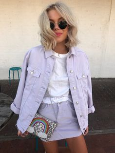 Blogger Laura Jade Stone with our From St Xavier X How Two Live This Is Living Clutch