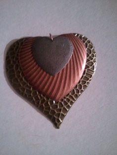 tri pendant. wear w/large brass multi heart earrings