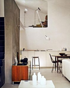 lamps, materials, cut-out wall; kitchen sans upper cabinets