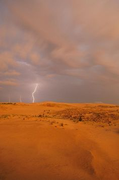 ✮ Lightning flashes above a sand dune in Jockey's Ridge State Park