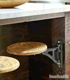 Love this idea of putting stools on hinges under a bar or island.