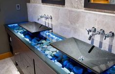 stone bathroom sinks and countertop with beach pebbles