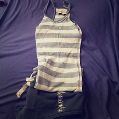 A&F striped tank A&F striped racer back tank. Blue and white stripes. Size XS. Too small for me now. Cute with jean shorts and flip flops for the summer. Abercrombie & Fitch Tops Tank Tops