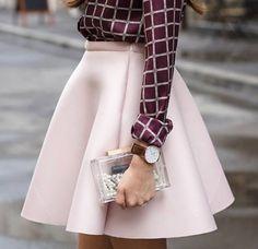 babypink skirt with a darker blouse and entransparent bag