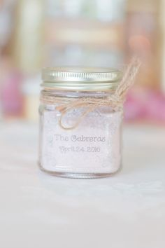 Add a sticker with your name and wedding date to the wedding favors for a custom touch. Photo credit: The Lockharts
