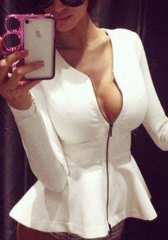 Front view of model in white zip-up peplum blazer
