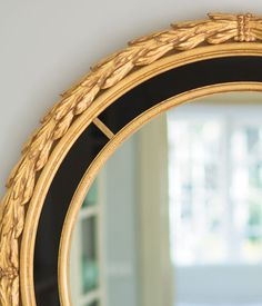 mirror | round Italian Neoclassic style carved wood mirror with antique gold leaf finish and black glass trim; Neoclassic mirror; Neoclassic style