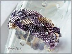 braided bracelet Have a pattern like this with 5 strands. It's lovely, once you figure out the braid!