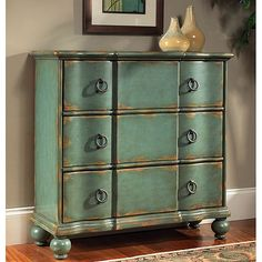<li>Hand-painted chest features a blue/green distressed finish</li> <li>Living room furniture is constructed of hardwood and MDF</li> <li>Accent chest has antique brass finish hardware</li>