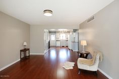 Mahogany wood laminate flooring, overhead lighting, Behr Castle Path paint