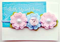 Newborn headband from Giddy Up and Grow on Etsy.  I know a not yet born niece who's going to need this.