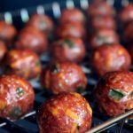 Cream cheese stuffed meatballs made with lots of jalapeno and cheddar and smoke cooked until perfect. These are unbelievably delicious and just the right size!