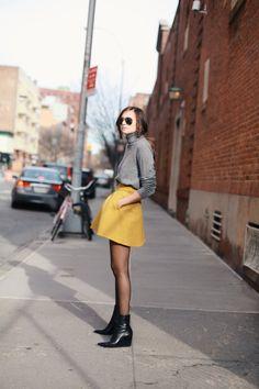 Wearing: Carven Skirt | Equipment Sweater | Balenciaga Booties