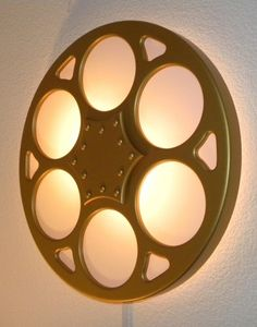 Home Theater Wall Decor metal wall art movie theater home decor movie reel. $29.99, via