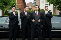 Groomsmen in front of limo.