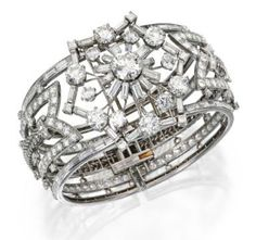 Platinum and Diamond Bangle-Bracelet-Brooch Combination, Oscar Heyman & Brothers, 1956