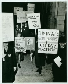 A protest demanding the dissolution of racial barriers in the placement of clergy, circa 1966. The Episcopal Society for Cultural and Racial Unity (ESCRU) was an organization of Episcopalians committed to full racial integration and reconciliation within the Church and American society. ESCRU was active between 1959 and 1970.