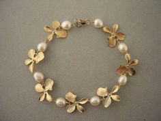 Items similar to Gold Flower and Pearl Bracelet, Bridesmaids Jewelry, Bridal Jew. - Items similar to Gold Flower and Pearl Bracelet, Bridesmaids Jewelry, Bridal Jewelry on Etsy – G - Bridesmaid Bracelet, Bridal Bracelet, Pearl Bracelet, Pearl Jewelry, Pendant Jewelry, Wedding Jewelry, Wire Necklace, Silver Jewellery, Ring Earrings