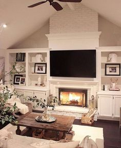 I love the fireplace in this room! I am also loving the built ins and the coffee table. So cozy!! #familyroom #fireplace