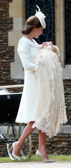 Kate Middleton cradled Princess Charlotte while wearing an all-white look.