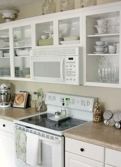 Remove upper cabinet doors. If glass door fronts are out of the budget but you want to open up a bit of space, try simply removing the doors to your upper kitchen cabinets. It's an easy change to make (just unscrew the doors and fill and paint the holes) that can add a sense of spaciousness to a small kitchen.