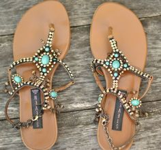 Pretty turquoise jeweled sandals.