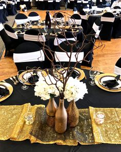 Black, white and gold party with glitter gold bottle centerpieces Retirement Party Centerpieces, Winter Table Centerpieces, Black And Gold Centerpieces, Black And Gold Party Decorations, Graduation Table Decorations, White And Gold Decor, Black And Gold Theme, Gold Wedding Centerpieces, Bottle Centerpieces