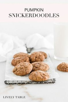 Soft and chewy pumpkin snickerdoodles are the most perfect fall cookie, full of warming fall spices and real pumpkin! Grab a cup of cider or glass of milk and dig into these easy seasonal cookies! #vegetarian #nutfree, #vegan option #pumpkin #cookies #dessert #snickerdoodles #fall #baking #falldessert #recipes