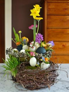 To make the ultimate centerpiece, group egg vases together in faux nests or an Easter basket. Dye some of the eggs to add more color to the table. Photo courtesy of Kim Foren
