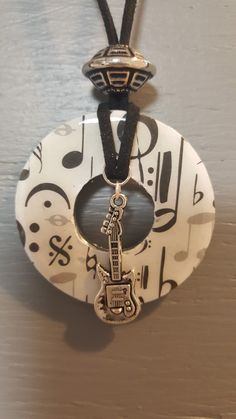 Washer pendant with music scrapbook paper, musical charm, with a bead and cording. Resin Jewelry, Jewelry Crafts, Jewelry Art, Beaded Jewelry, Jewelry Accessories, Jewelry Necklaces, Jewelry Design, Jewellery Box, Jewelry Ideas