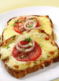 When you're craving pizza... Whole grain bread low-fat mozzarella cheese, sliced thick tomato slices, white onion slices, and green onion.