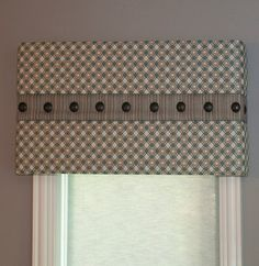 I like it! It would be so blah without the center band and large nail heads. Don't be afraid to try something new! #valance #cornice