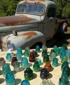 Antique glass insulators Electric Insulators, Insulator Lights, Glass Insulators, Antique Glassware, Antique Bottles, Bottles And Jars, Mason Jars, Chandelier, Vintage Jars
