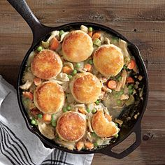 Biscuit-Topped Chicken Potpie. om nom nom. threw in lots of left over roasted veggies and used canned biscuits.