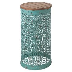 Rest your bedside essentials atop this filigreed end table for a bold nightstand, or add it to the library to hold a colorful lamp.   ...