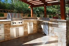 This outdoor kitchen just GLEAMS! Would love to grill up some steaks here. Design by the Arcadia Design Group in Centennial, CO. For great tips on caring for your outdoor kitchen surfaces read here http://www.landscapingnetwork.com/outdoor-kitchens/maintenance.html