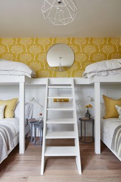 Bunk beds and sunny yellow hues make this kids' room come alive