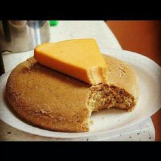 Me wah some! Bulla and Cheese Jamaican Desserts, Jamaican Cuisine, Jamaican Recipes, Jamaican Dishes, Carribean Food, Caribbean Recipes, Bulla Cake Recipe, Jamaica Food, Jamaica Jamaica