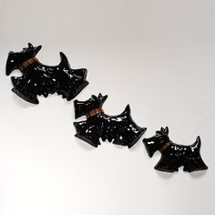 Perfect present for Scottie dog lovers!  Designed and handmade in Scotland. A set of 3 different sized wall mounted ceramic Scotties.