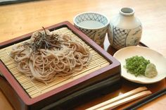 Zaru Soba is cold buckwheat noodles famous in Nagano prefecture. There are many variations in how it is eaten or served, although the most common include thinly sliced green onions, wasabi, and nori. You get a noodle dipping cup and bottle of dipping sauce or liquid called soba tsuyu.