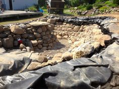 Picture: Pond Rock & Boulder Installation Rochester NY By Acorn Ponds & Waterfalls