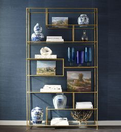 Extensively made in France during the latter part of the 18th century, an étagère consists of a series of stages or shelves for the reception of small objects. Our modern take, however, is much larger with ample shelving space to fill with books, vases, collectibles, and photos. The hand-applied gold leaf and glass shelves add a sophisticated glamour to this piece with enough shine to brighten up any wall space.