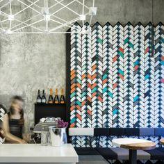 Studio+Ramoprimo+creates+chevron-patterned+brick+walls+inside+Beijing+wine+bar