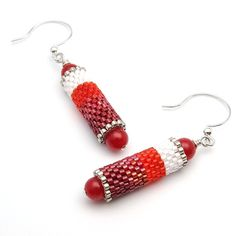 These striking and stylish red ombre earrings are cylinder shaped beaded beads woven around a hollow core and embellished with red Czech glass beads. The earrings are finished with high quality sterling silver round ear wires.  Approximately 1 1/4 inch in length. They are light and comfortable to wear.  Free USA shipping and sent in a gift box.  Thanks for looking at my Etsy shop.
