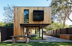 A home in Melbourne by architects tenfiftyfive boasts a kitchen that connects directly to the exterior environment. No longer do those cooking need to be separated from the rest of the happenings.