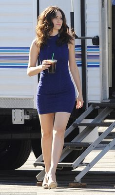 Blue beauty: Emmy Rossum sizzled in a form-fitting blue frock for some filming on location in Los Angeles on Thursday