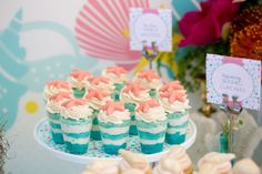 desserts from a chic and glamorous mermaid under the sea party by wh hostess with unique decoration ideas, darling food presentation, a sea-worthy dessert table, and darling party favors.