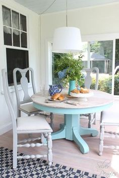 A sunroom furniture set makeover with a lovely table finished in a custom mix of Pure White and Provence Chalk Paint® decorative paint by Annie Sloan. A wash of Old White was applied to the top while the chairs received Paris Grey   By Finding Silver Pennies